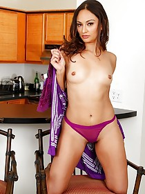 Purple get-up brunette furiously masturbating up close in the kitchen