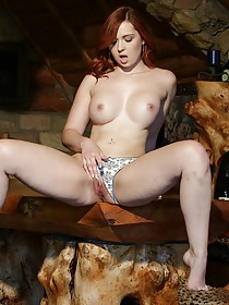 Panties-wearing redhead fingers her pussy in an empty chic room