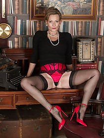 Stockings-clad luxurious-looking blonde MILF showing off her body